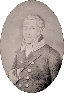 Portrait of a man in a coat. His right hand is inside his lapel. He's the subject of this page on mapping the Haitian Diaspora in the 19th century